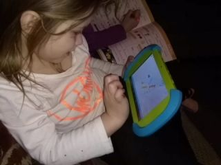 child on pbs tablet