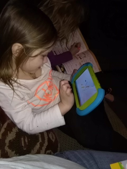child-on-pbs-tablet